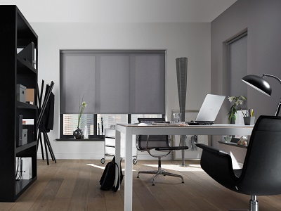 Grey roller blinds in an office