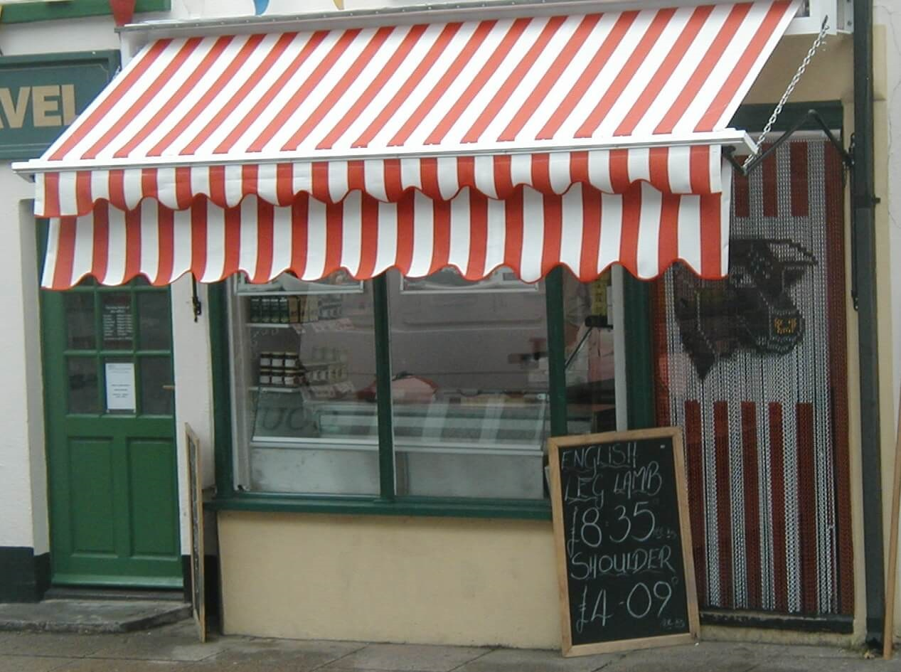 Red and white stripe drop arm awning