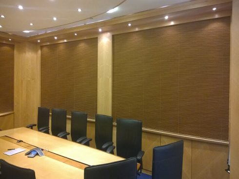 Electric venetian blinds in a boardroom