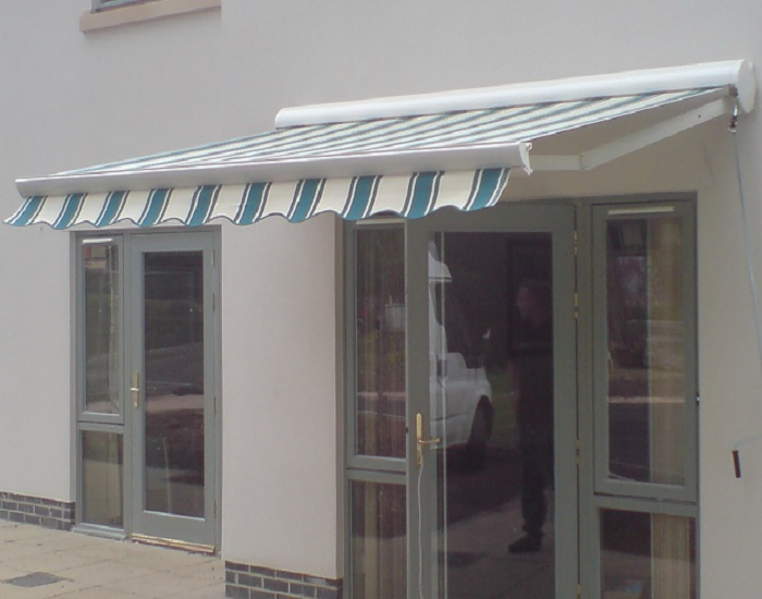 Commercial folding arm awning